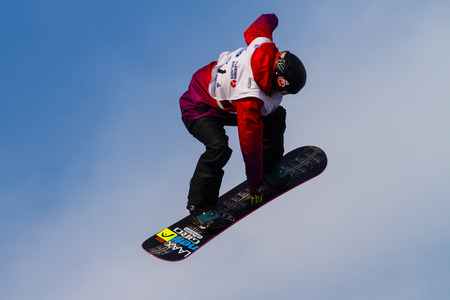 fis: ISTANBUL, TURKEY - DECEMBER 20, 2014: Sina Candrian jump in FIS Snowboard World Cup Big Air. This is first Big Air event for both, men and women. Editorial