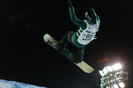 ISTANBUL, TURKEY - DECEMBER 20, 2014: Jonas Boesiger jump in FIS Snowboard World Cup Big Air. This is first Big Air event for both, men and women.