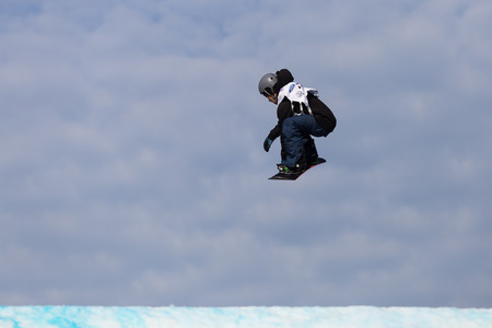 fis: ISTANBUL, TURKEY - DECEMBER 20, 2014: Ville Paumola jump in FIS Snowboard World Cup Big Air. This is first Big Air event for both, men and women.