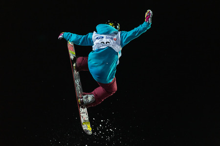 maas: ISTANBUL, TURKEY - DECEMBER 20, 2014: Cheryl Maas jump in FIS Snowboard World Cup Big Air. This is first Big Air event for both, men and women. Editorial