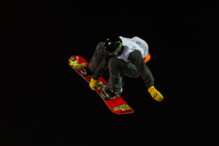 ISTANBUL, TURKEY - DECEMBER 20, 2014: Brandon Davis jump in FIS Snowboard World Cup Big Air. This is first Big Air event for both, men and women.