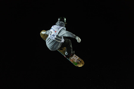 fis: ISTANBUL, TURKEY - DECEMBER 20, 2014: Sebbe De Buck jump in FIS Snowboard World Cup Big Air. This is first Big Air event for both, men and women.