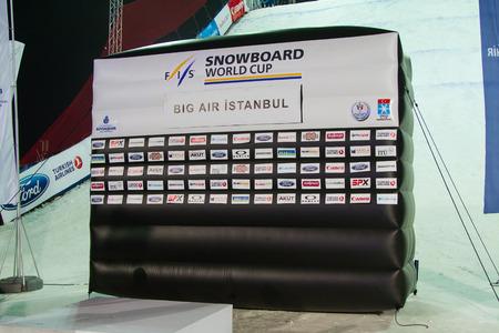 fis: ISTANBUL, TURKEY - DECEMBER 20, 2014: Podium of FIS Snowboard World Cup Big Air. This is first Big Air event for both, men and women.