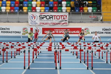 steeplechase: ISTANBUL, TURKEY - DECEMBER 28, 2014: Athletes run steeplechase during Athletics record attempt races in Asli Cakir Alptekin Athletics hall, Istanbul. Editorial