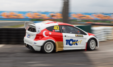fatih: ISTANBUL, TURKEY - OCTOBER 11, 2014: Fatih Kara drives RX Lites of Toksport WRT Team in FIA World Rallycross Championship. Editorial