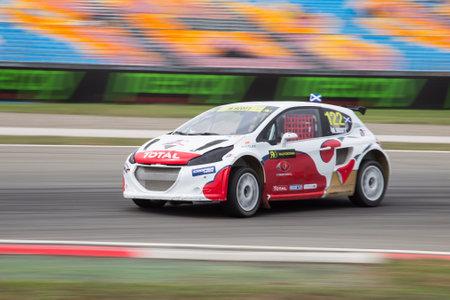 fia: ISTANBUL, TURKEY - OCTOBER 11, 2014: Marc Scott drives Peugeot 208 of Albatec Racing Team in FIA World Rallycross Championship.