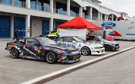 fia: ISTANBUL, TURKEY - OCTOBER 11, 2014: Drift cars in garage area of Istanbul Park circuit during FIA World Rallycross Championship.