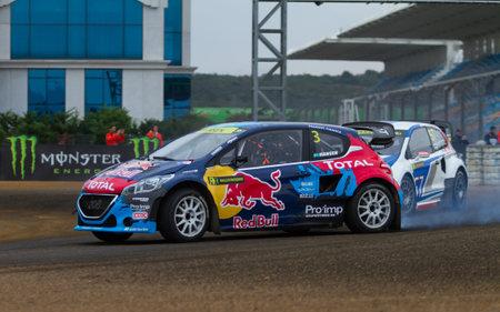 fia: ISTANBUL, TURKEY - OCTOBER 12, 2014: Timmy Hansen drives Peugeot 208 of Team Peugeot Hansen in FIA World Rallycross Championship.