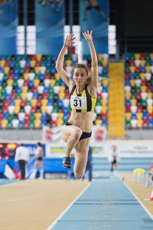 olympic game: ISTANBUL, TURKEY - JANUARY 24, 2015: Athlete Busra Mutay triple jump during Turkish Athletic Federation Indoor Athletics Competition in Asli Cakir Alptekin Athletics hall
