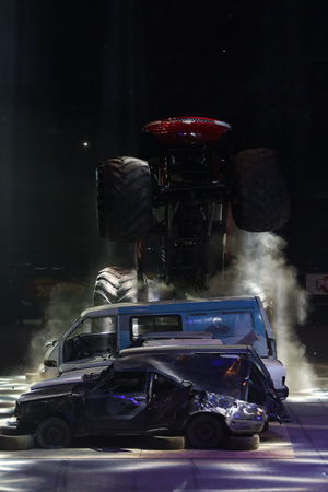 crush on: ISTANBUL, TURKEY - JANUARY 31, 2015: Monster Truck Lil Devil crush to old cars in Sinan Erdem Dome during Monster Hot Wheels stunt show. Stock Photo