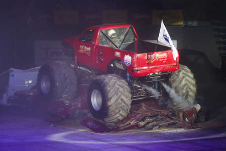 crush on: ISTANBUL, TURKEY - JANUARY 31, 2015: Monster Truck Lil Devil crush to old cars in Sinan Erdem Dome during Monster Hot Wheels stunt show. Editorial