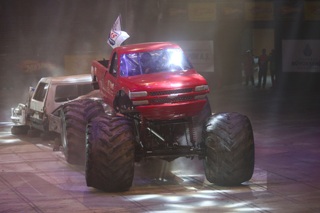 crush on: ISTANBUL, TURKEY - FEBRUARY 01, 2015: Monster Truck Lil Devil crush to old cars in Sinan Erdem Dome during Monster Hot Wheels stunt show.