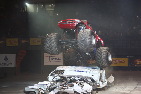 ISTANBUL, TURKEY - FEBRUARY 01, 2015: Monster Truck Lil Devil crush to old cars in Sinan Erdem Dome during Monster Hot Wheels stunt show.
