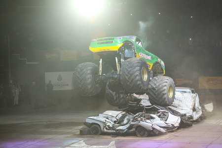 jalopy: ISTANBUL, TURKEY - FEBRUARY 01, 2015: Monster Truck Extreme Revisited crush to old cars in Sinan Erdem Dome during Monster Hot Wheels stunt show.