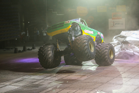 crush on: ISTANBUL, TURKEY - FEBRUARY 01, 2015: Monster Truck Extreme Revisited crush to old cars in Sinan Erdem Dome during Monster Hot Wheels stunt show.