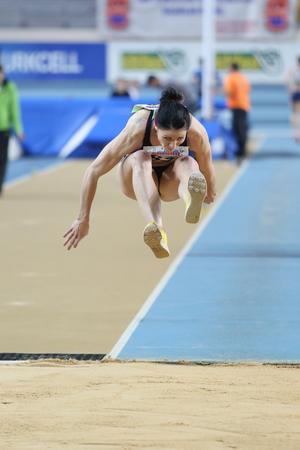 olympic game: ISTANBUL, TURKEY - FEBRUARY 21, 2015: Slavonian athlete Babsek Sasa triple jump during Balkan Athletics Indoor Championships in Asli Cakir Alptekin Athletics hall.