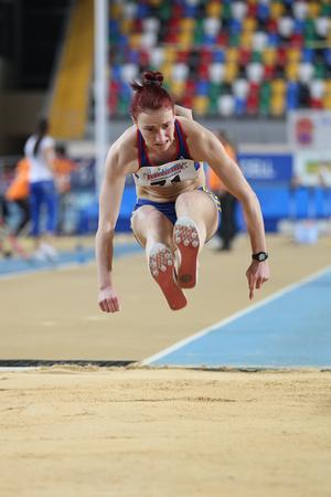 rumanian: ISTANBUL, TURKEY - FEBRUARY 21, 2015: Rumanian athlete Panturoiu Elena triple jump during Balkan Athletics Indoor Championships in Asli Cakir Alptekin Athletics hall.