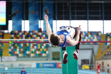 olympic game: ISTANBUL, TURKEY - FEBRUARY 21, 2015: Moldovan athlete Andrei Miticov high jump during Balkan Athletics Indoor Championships in Asli Cakir Alptekin Athletics hall. Editorial