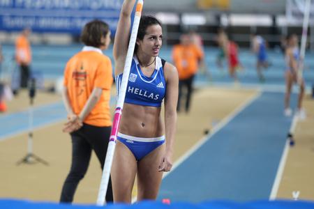 ISTANBUL, TURKEY - FEBRUARY 21, 2015: Greek athlete Stela Iro Ledaki pole vaulting during Balkan Athletics Indoor Championships in Asli Cakir Alptekin Athletics hall.