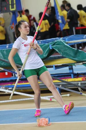 ISTANBUL, TURKEY - FEBRUARY 21, 2015: Bulgarian athlete Mania Bulkina pole vaulting during Balkan Athletics Indoor Championships in Asli Cakir Alptekin Athletics hall.