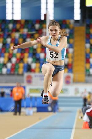 olympic game: ISTANBUL, TURKEY - FEBRUARY 21, 2015: Moldovan athlete Natalia Cipilencu triple jump during Balkan Athletics Indoor Championships in Asli Cakir Alptekin Athletics hall.