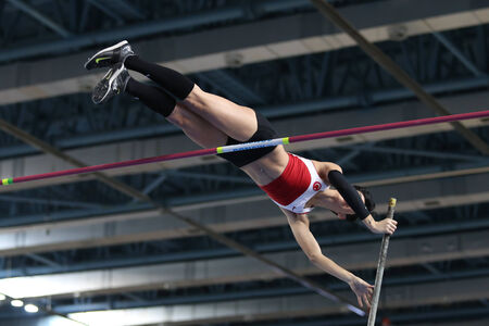 ISTANBUL, TURKEY - FEBRUARY 21, 2015: Turkish athlete Buse Arikazan pole vaulting during Balkan Athletics Indoor Championships in Asli Cakir Alptekin Athletics hall.