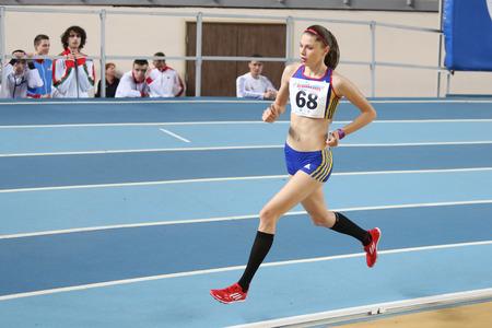 rumanian: ISTANBUL, TURKEY - FEBRUARY 21, 2015: Rumanian athlete Bobocea Claudia running during Balkan Athletics Indoor Championships in Asli Cakir Alptekin Athletics hall. Editorial