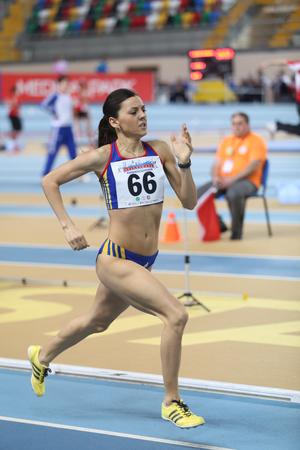 rumanian: ISTANBUL, TURKEY - FEBRUARY 21, 2015: Rumanian athlete Nunu Mihaela running during Balkan Athletics Indoor Championships in Asli Cakir Alptekin Athletics hall. Editorial