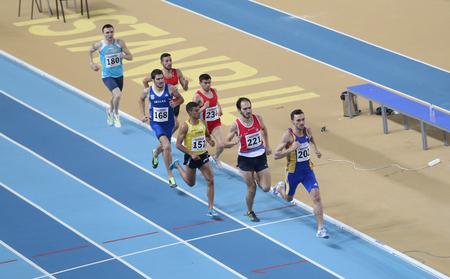 olympic game: ISTANBUL, TURKEY - FEBRUARY 21, 2015: Athletes running during Balkan Athletics Indoor Championships in Asli Cakir Alptekin Athletics hall.