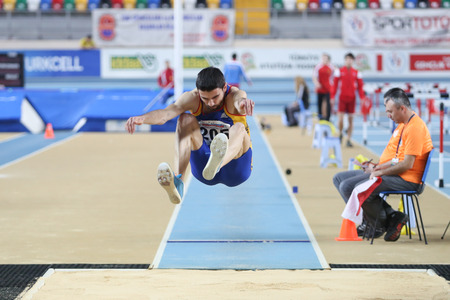 ISTANBUL, TURKEY - FEBRUARY 21, 2015: Rumanian athlete Vasile Adrian long jump during Balkan Athletics Indoor Championships in Asli Cakir Alptekin Athletics hall. Editorial
