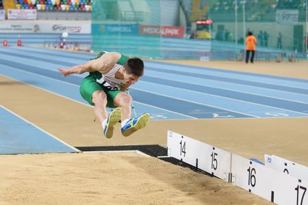 rumen: ISTANBUL, TURKEY - FEBRUARY 21, 2015: Bulgarian athlete Rumen Dimitrov triple jump during Balkan Athletics Indoor Championships in Asli Cakir Alptekin Athletics hall. Editorial