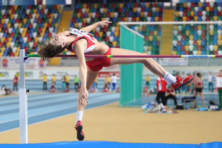 ISTANBUL, TURKEY - FEBRUARY 21, 2015: Montenegrin athlete Marija Vukovic high jump during Balkan Athletics Indoor Championships in Asli Cakir Alptekin Athletics hall. Editorial