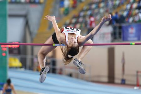 pinar: ISTANBUL, TURKEY - FEBRUARY 21, 2015: Turkish athlete Pinar Aday high jump during Balkan Athletics Indoor Championships in Asli Cakir Alptekin Athletics hall. Editorial