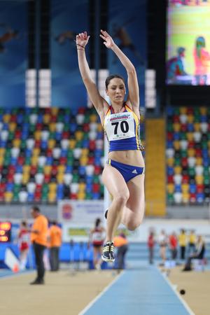 rumanian: ISTANBUL, TURKEY - FEBRUARY 21, 2015: Rumanian athlete Marincu Florentina long jump during Balkan Athletics Indoor Championships in Asli Cakir Alptekin Athletics hall.
