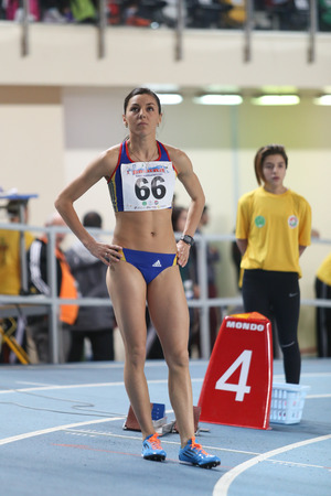 rumanian: ISTANBUL, TURKEY - FEBRUARY 21, 2015: Rumanian athlete Nunu Mihaela before 4x400 relay race during Balkan Athletics Indoor Championships in Asli Cakir Alptekin Athletics hall. Editorial