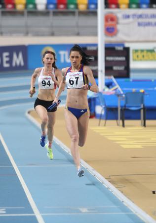 relay race: ISTANBUL, TURKEY - FEBRUARY 21, 2015: Athletes running 4x400 relay race during Balkan Athletics Indoor Championships in Asli Cakir Alptekin Athletics hall. Editorial