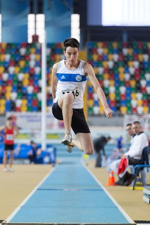 ramazan: ISTANBUL, TURKEY - FEBRUARY 01, 2015: Athlete Ramazan Senkal long jump during Turkish Athletic Federation Olympic Threshold Indoor Competitions in Asli Cakir Alptekin Athletics hall