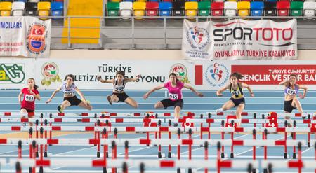 steeplechase: ISTANBUL, TURKEY - FEBRUARY 01, 2015: Athletes run steeplechase during Turkish Athletic Federation Olympic Threshold Indoor Competitions in Asli Cakir Alptekin Athletics hall