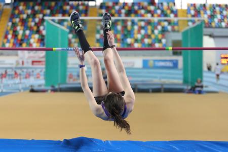 olympic game: ISTANBUL, TURKEY - FEBRUARY 15, 2015: Athlete Miray Akbulut high jump during Turkcell Juniors and Seniors Athletics Turkey Indoor Championship in Asli Cakir Alptekin Athletics hall