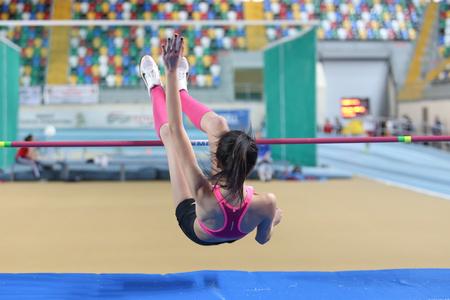 ISTANBUL, TURKEY - FEBRUARY 15, 2015: Athlete Merve Menekse high jump during Turkcell Juniors and Seniors Athletics Turkey Indoor Championship in Asli Cakir Alptekin Athletics hall