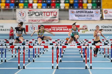steeplechase: ISTANBUL, TURKEY - FEBRUARY 15, 2015: Athletes steeplechase running during Turkcell Juniors and Seniors Athletics Turkey Indoor Championship in Asli Cakir Alptekin Athletics hall