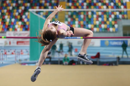 ISTANBUL, TURKEY - FEBRUARY 15, 2015: Athlete Pınar Aday high jump during Turkcell Juniors and Seniors Athletics Turkey Indoor Championship in Asli Cakir Alptekin Athletics hall
