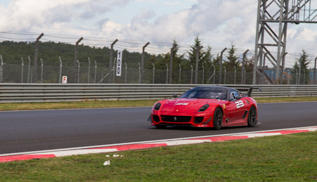 programmes: ISTANBUL, TURKEY - OCTOBER 25, 2014: P. Hannell drives Ferrari 599XX during XX Programmes of Ferrari Racing Days in Istanbul Park Racing Circuit Editorial