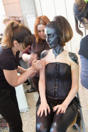 bodypaint: ISTANBUL, TURKEY - MARCH 15, 2015: Girl body painting Work shop in Beauty and Care exhibition in Istanbul