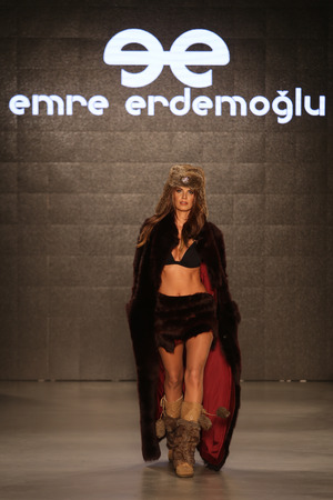supermodel: ISTANBUL, TURKEY - MARCH 17, 2015: Turkish model Tulin Sahin showcases one of the latest creations by Emre Erdemoglu in Mercedes-Benz Fashion Week Istanbul Editorial