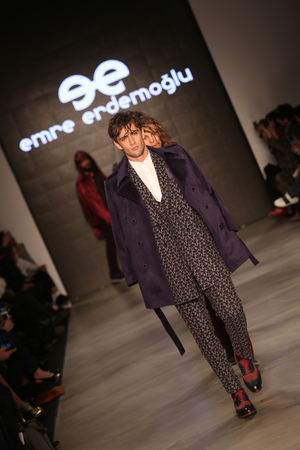 the latest models: ISTANBUL, TURKEY - MARCH 17, 2015: Models showcase the latest creations by Emre Erdemoglu in Mercedes-Benz Fashion Week Istanbul