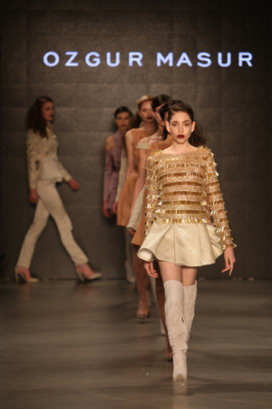 the latest models: ISTANBUL, TURKEY - MARCH 17, 2015: Models showcase the latest creations by Ozgur Masur in Mercedes-Benz Fashion Week Istanbul