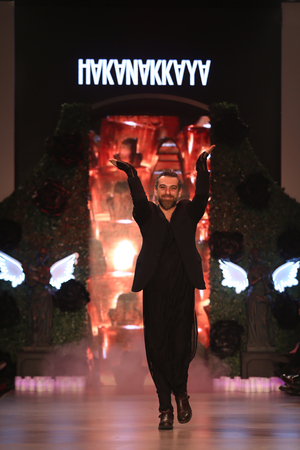 fashion week: ISTANBUL, TURKEY - MARCH 18, 2015: Designer Hakan Akkaya after his runway in Mercedes-Benz Fashion Week Istanbul