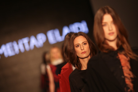 the latest models: ISTANBUL, TURKEY - MARCH 19, 2015: Models showcase the latest creations by Mehtap Elaidi in Mercedes-Benz Fashion Week Istanbul