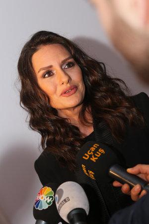 fashion week: ISTANBUL, TURKEY - MARCH 19, 2015: Actress Yasemin Ergene Ozilhan in Lounge of Mercedes-Benz Fashion Week Istanbul Editorial